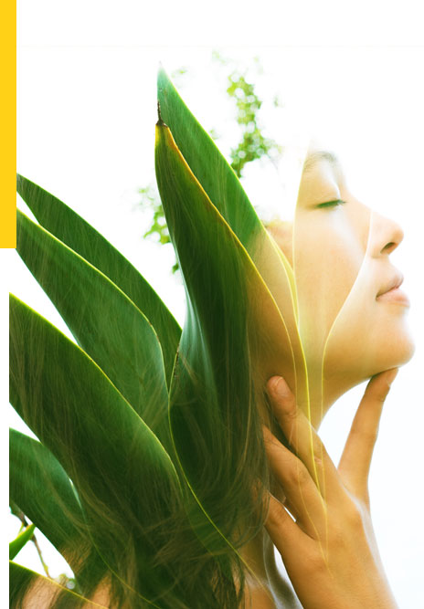 Double exposure of growing plant and contemplative woman's side profile